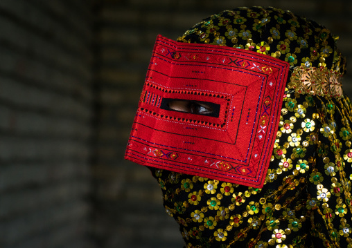 a bandari woman wearing a traditional mask called the burqa, Hormozgan, Minab, Iran