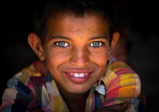 smiling gypsy boy with beautiful eyes, Central County, Kerman, Iran
