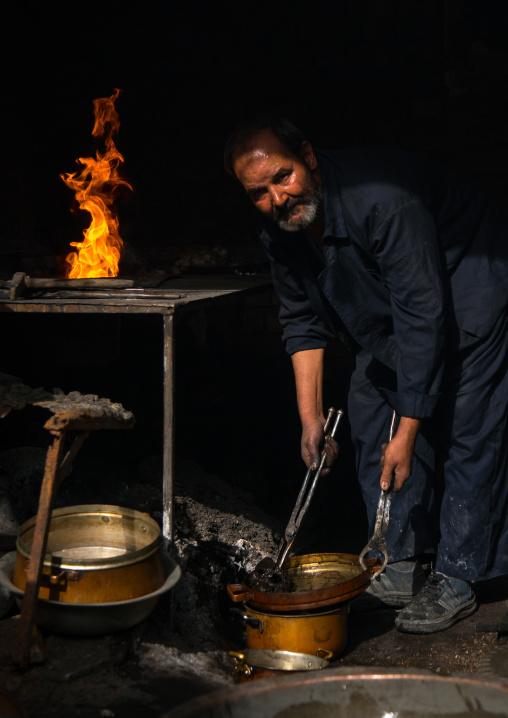 coppersmith in ganjali bazaar, Central County, Kerman, Iran