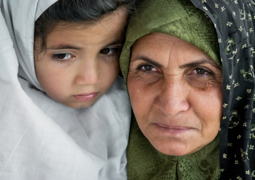 iranian woman with her daughter, Central County, Kerman, Iran