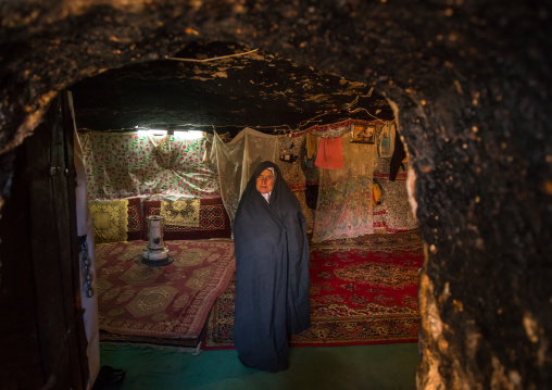 Old widow woman in her troglodyte house, Kerman province, Meymand, Iran