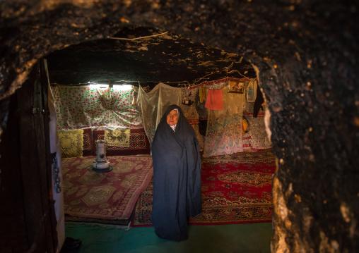 old widow woman in her troglodyte house, Kerman province, Meymand, Iran