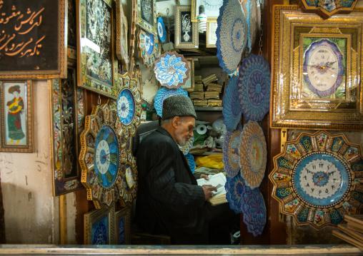 Old man reading koran in his shop, Isfahan province, Isfahan, Iran