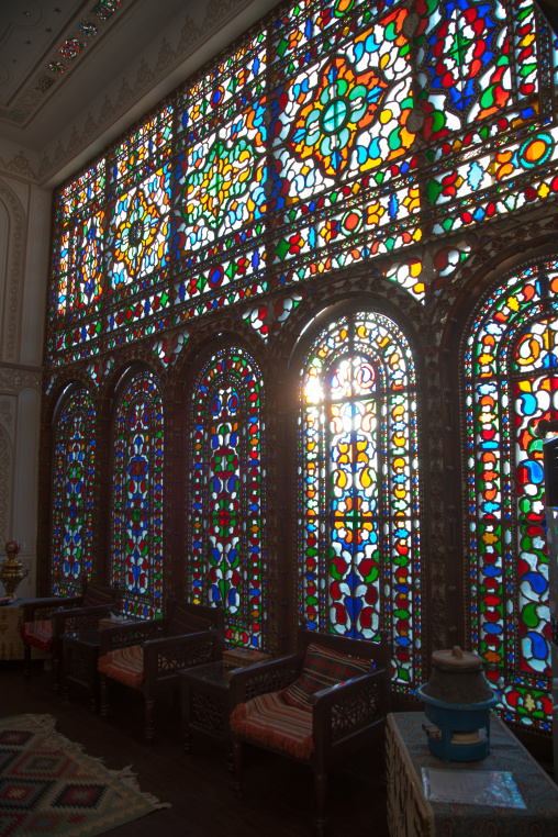suite room with its beautiful coloured glass window in atigh traditional hotel, Isfahan Province, isfahan, Iran