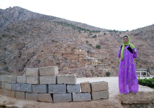 Woman In Front Of The Old Kurdish Village Of Palangan, Iran