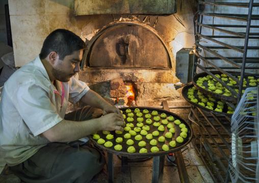Man Preparing Some Berenji Cakes, Kermanshah, Iran