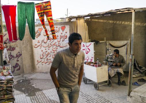 Man Passing In The Bazaar, Kermanshah, Iran