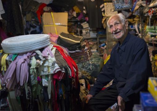 Old Man Selling Clothes In The Bazaar, Kermanshah, Iran