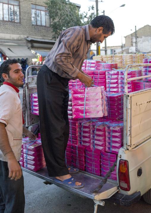 Men Chargiing Cakes Boxes In The Bazaar, Kermanshah, Iran