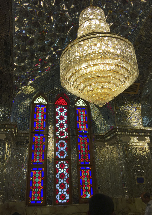 The stained glass windows and huge chandelier of the prayer hall of the shah-e-cheragh mausoleum, Fars province, Shiraz, Iran