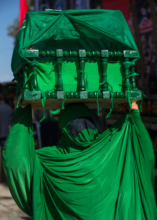 Iranian Shiite Muslim Woman On The Day Of Tasua With Her Face Covered By A Green Veil And Collecting Money In A Craddle, Lorestan Province, Khorramabad, Iran