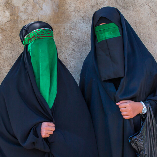 Iranian Shiite Muslim Women Mourning Imam Hussein On The Day Of Tasua With Their Faces Covered By A Green Veil, Lorestan Province, Khorramabad, Iran