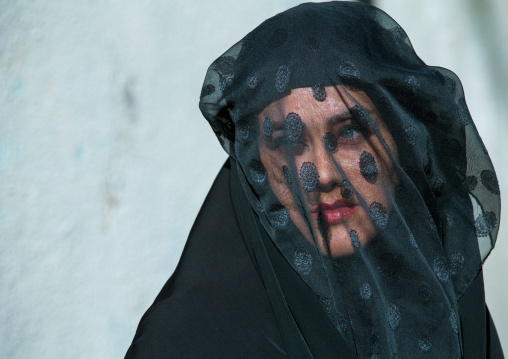 Iranian Shiite Muslim Woman Mourning Imam Hussein On The Day Of Tasua With Her Face Covered By A Veil, Lorestan Province, Khorramabad, Iran