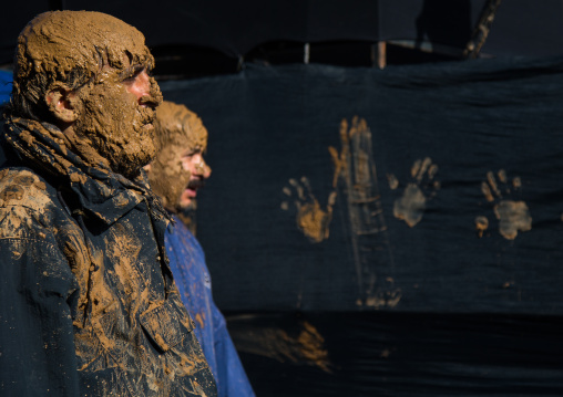 Iranian Shiite Muslim Men Covered In Mud During Ashura Day, Kurdistan Province, Bijar, Iran