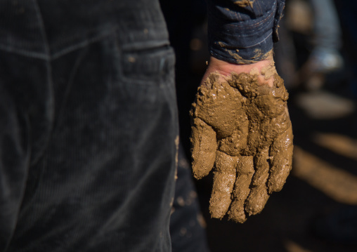 Iranian Shiite Muslim Man Hand Covered In Mud During Ashura Day, Kurdistan Province, Bijar, Iran
