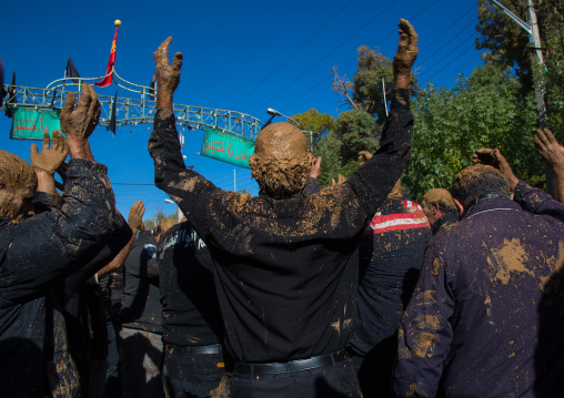 Iranian Shiite Muslim Men Covered In Mud, Chanting And Self-flagellating During Ashura, The Day Of The Death Of Imam Hussein, Kurdistan Province, Bijar, Iran