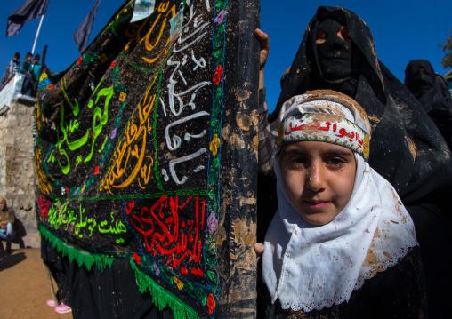 Iranian Shiite Muslim Girl Covered In Mud During Ashura, The Day Of The Death Of Imam Hussein, Kurdistan Province, Bijar, Iran