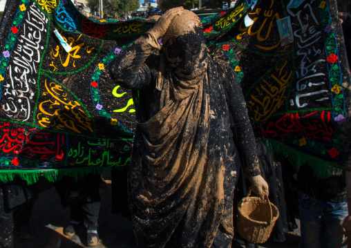 Iranian Shiite Muslim Woman Putting Mud On Her Head During Ashura, The Day Of The Death Of Imam Hussein, Kurdistan Province, Bijar, Iran