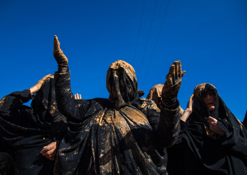 Iranian Shiite Muslim Women Covered In Mud, Chanting And Self-flagellating During Ashura, The Day Of The Death Of Imam Hussein, Kurdistan Province, Bijar, Iran