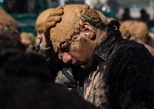 Iranian Shiite Muslim Man Covered In Mud, Chanting And Self-flagellating During Ashura Day, Kurdistan Province, Bijar, Iran