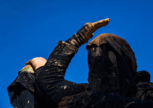 Iranian Shiite Muslim Woman Covered In Mud, Chanting And Self-flagellating During Ashura, The Day Of The Death Of Imam Hussein, Kurdistan Province, Bijar, Iran