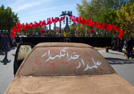 A Car Covered Of Mud In Front Of An Alam On Ashura, The Day Of The Death Of Imam Hussein, Kurdistan Province, Bijar, Iran