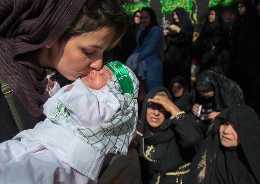 Iranian Shiite Muslim Woman Kissing Her Baby During Ashura Celebration, The Day Of The Death Of Imam Hussein, Kurdistan Province, Bijar, Iran
