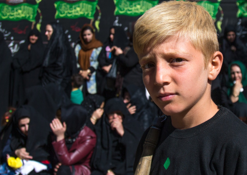 Blonde Kurdish Boy During Ashura Celebration, The Day Of The Death Of Imam Hussein, Kurdistan Province, Bijar, Iran