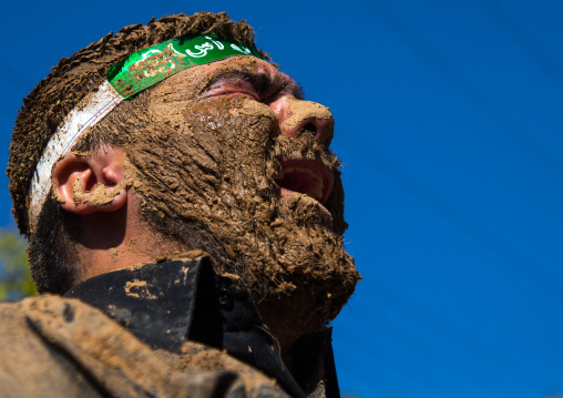 Iranian Shiite Muslim Man Covered In Mud Crying During Ashura Day, Kurdistan Province, Bijar, Iran