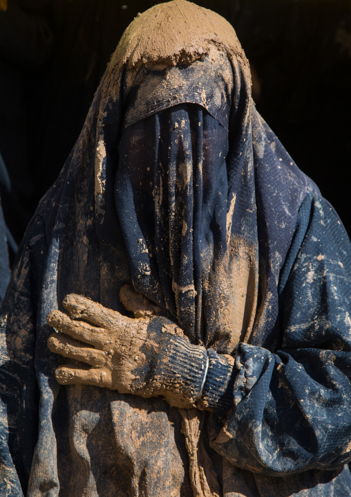 Iranian Shiite Muslim Woman Covered In Mud With Her Hand On Her Heart During Ashura, The Day Of The Death Of Imam Hussein, Kurdistan Province, Bijar, Iran