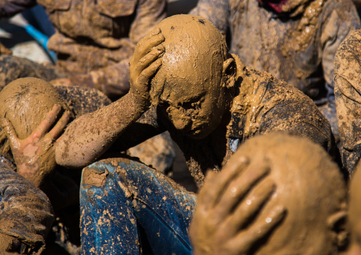 Iranian Shiite Muslim Men Covered In Mud Crying Together During Ashura, The Day Of The Death Of Imam Hussein, Kurdistan Province, Bijar, Iran