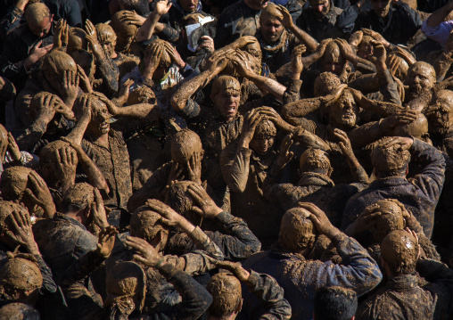 Iranian Shiite Muslim Men Covered In Mud, Chanting And Self-flagellating During Ashura, The Day Of The Death Of Imam Hussein, Kurdistan Province, Bijar, Iran