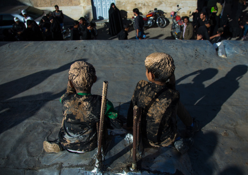 Iranian Shiite Muslim Boys Covered In Mud, Chanting And Self-flagellating During Ashura Day, Kurdistan Province, Bijar, Iran