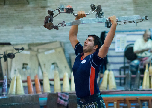Iranian Man Training With Kabbadeh Chain And Bow At Saheb A Zaman Club Zurkhaneh, Yazd Province, Yazd, Iran