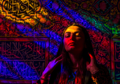 Iranian Woman Praying In The Nasir Ol Molk Mosque With Its Beautiful Coloured Glass Windows, Fars Province, Shiraz, Iran