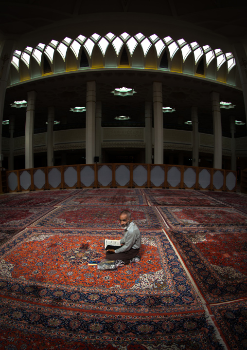 Iranian Shiite Muslim Man Reading The Koran In Fatima Al-masumeh Mosque, Fars Province, Shiraz, Iran