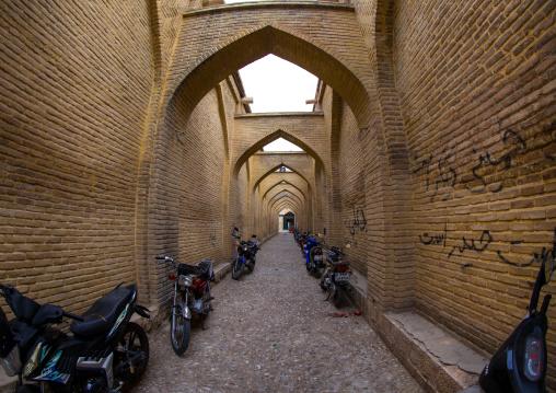 Motorbikes Parked Along A Narrow Street With Arches, Fars Province, Shiraz, Iran