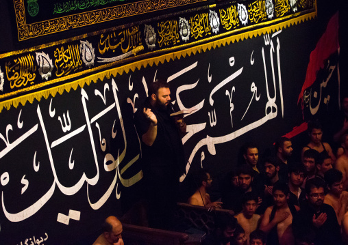 Iranian Shiite Muslim Man Leading Recitations And Songs With The Mad Of Hussein Mourners During Muharram, Isfahan Province, Kashan, Iran