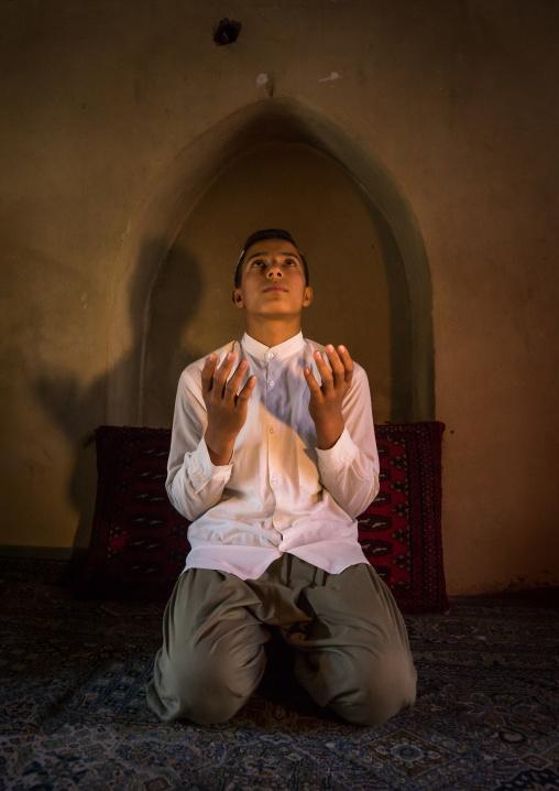 Iranian Shiite Muslim Student Praying In A Madrassah, Golestan Province, Karim Ishan, Iran