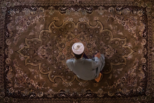 Iranian Shiite Muslim Kneeling And Praying In Mosque, Golestan Province, Karim Ishan, Iran
