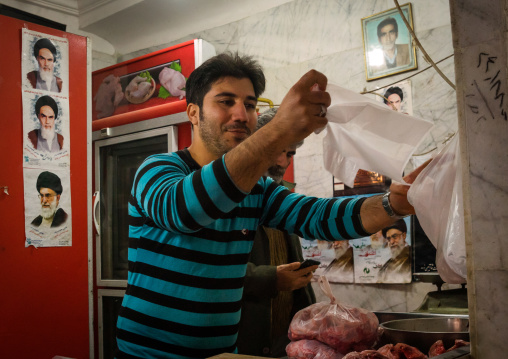 Butcher In His Shop Decorated With Ayatollah Khomeini Pictures, Golestan Province, Gorgan, Iran