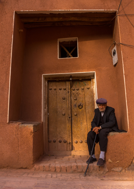 Old Man Sitting In Front Of An Ancient Building In Zoroastrian Village, Isfahan Province, Abyaneh, Iran