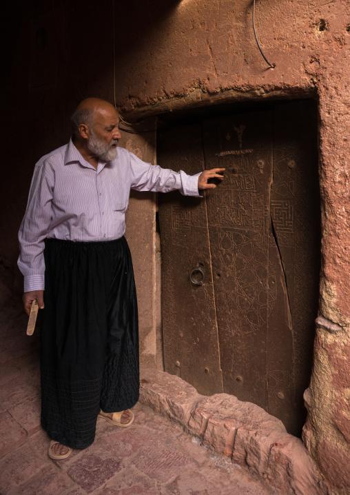 Old Man Opening A Door In Zoroastrian Village, Isfahan Province, Abyaneh, Iran