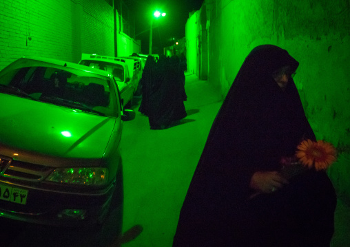 Iranian Women Wearing Chadors In The Street Lighten By Green Light During Muharram Celebration, Isfahan Province, Kashan, Iran