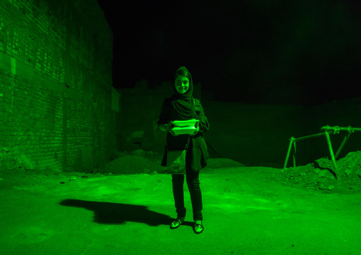 Iranian Shiite Muslim Girl Bringing Back Home Nazri Charity Food During Muharram, Isfahan Province, Kashan, Iran