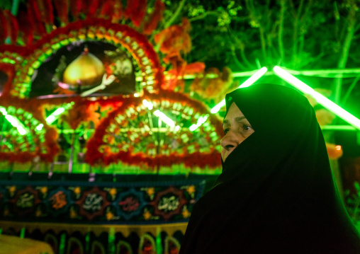 Iranian Shiite Muslim Woman Mourner Pausing Proudly In Front Of An Alam On Ashura, The Day Of The Death Of Imam Hussein, Isfahan Province, Kashan, Iran