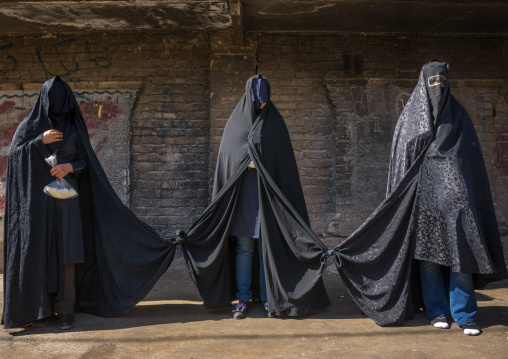 Iranian Shiite Women Mourning Hussein On Tasua Day With Their Faces Covered And Their Clothes Tied As They Must Not Speak, Lorestan Province, Khorramabad, Iran