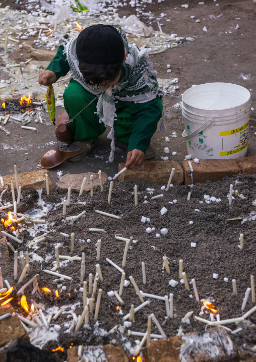 A Boy Lights Candles During Chehel Menbari Festival On Tasu'a Day To Commemorate The Martyrdom Anniversary Of Imam Hussein, Lorestan Province, Khorramabad, Iran