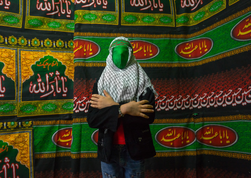 Iranian Young Man With Green Veil Covering His Face During Chehel Menbari Festival On Tasua To Commemorate The Martyrdom Of Hussein, Lorestan Province, Khorramabad, Iran
