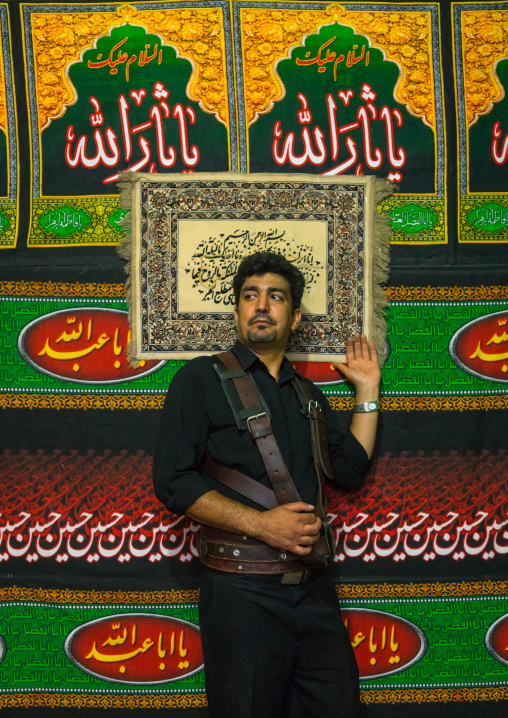 Iranian Shiite Alam Porter During Chehel Menbari Festival On Tasua Day To Commemorate The Martyrdom Of Imam Hussein, Lorestan Province, Khorramabad, Iran